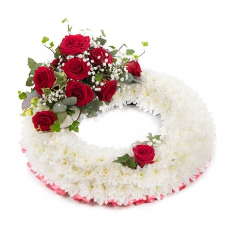 White based Wreath with red top spray SYM-314